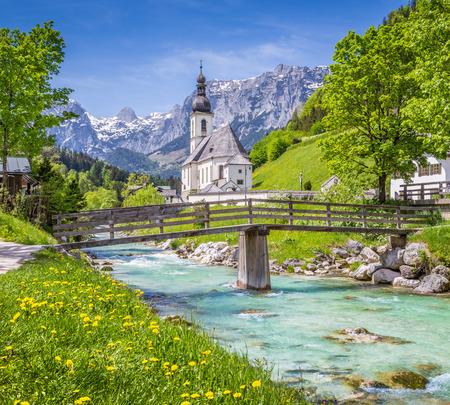 nationalpark: Scenic mountain landscape in the Bavarian Alps with famous Parish Church of St. Sebastian in the village of Ramsau in springtime, Nationalpark Berchtesgadener Land, Upper Bavaria, Germany Stock Photo