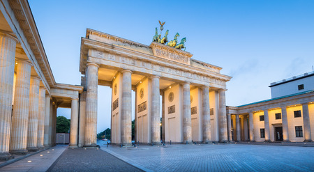 morning blue hour: Panoramic view of famous Brandenburg Gate, one of the best-known landmarks and national symbols of Germany, in twilight during blue hour at dawn, Berlin, Germany
