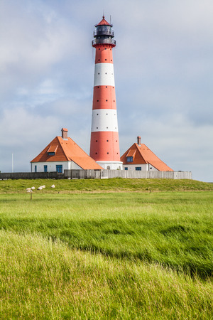 westerheversand lighthouse: Beautiful coastal landscape with traditional lighthouse in the background at North Sea in Nordfriesland, Schleswig-Holstein, Germany