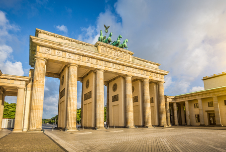 Famous Brandenburger Tor, one of the best-known landmarks and national symbols of Germany, in beautiful golden morning light at sunrise with lens flare effect, Berlin, Germany Stock fotó