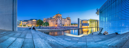 lobe: Panoramic view of Berlin government district with famous Reichstag building and Paul Lobe Haus Deutscher Bundestag at dusk, Berlin, Germany