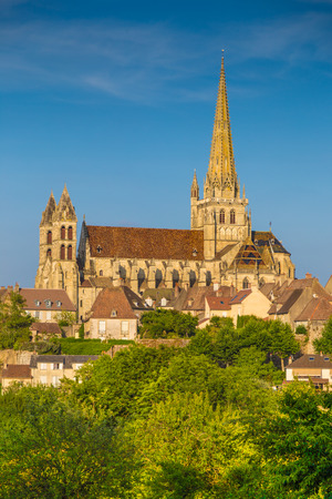 cathedrale: Historic town of Autun with famous Cathedrale Saint-Lazare dAutun on top of a hill in golden evening light at sunset, Saone-et-Loire department, Burgundy, France
