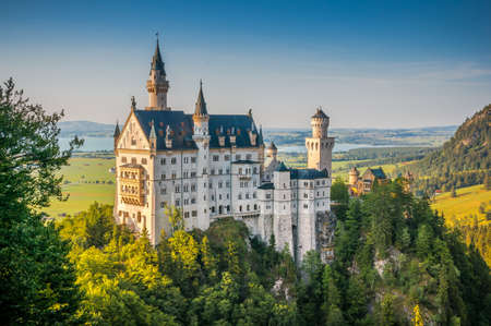 cinderella: Beautiful view of world-famous Neuschwanstein Castle, the 19th century Romanesque Revival palace built for King Ludwig II, in beautiful evening light at sunset, Fussen, southwest Bavaria, Germany
