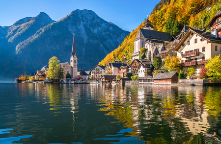 austrian village: Scenic panoramic picture-postcard view of famous Hallstatt mountain village with Hallstatter See in the Austrian Alps in beautiful golden morning light in fall, Salzkammergut, Austria