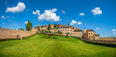 st  francis: Beautiful panoramic view of peaceful gardens of famous Basilica of St. Francis of Assisi Basilica Papale di San Francesco in Assisi, Umbria, Italy Stock Photo