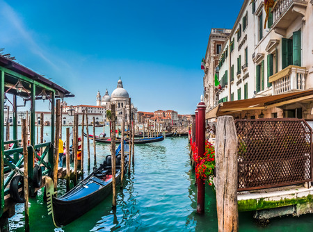basilica: Beautiful view of traditional Gondola on Canal Grande with historic Basilica di Santa Maria della Salute in the background on a sunny day in Venice, Italy