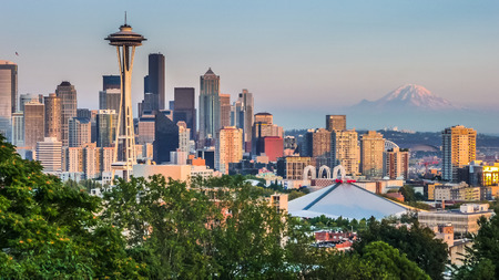 Seattle skyline panorama seen from Kerry Park at sunset in golden evening light with Mount Rainier in the background, Washington State, United States of America Stock Photo