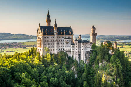 castle: Beautiful view of world-famous Neuschwanstein Castle, the 19th century Romanesque Revival palace built for King Ludwig II, in beautiful evening light at sunset, Fussen, southwest Bavaria, Germany