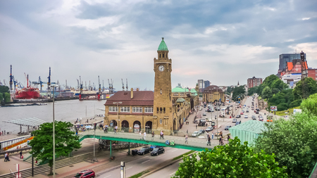 reeperbahn: Famous Hamburger Landungsbruecken with harbor and ships on Elbe river, St. Pauli district, Hamburg, Germany