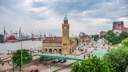 reeperbahn: Famous Hamburger Landungsbruecken with harbor and ships on Elbe river, St. Pauli district, Hamburg, Germany