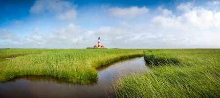 salt marsh: Beautiful landscape with famous Westerheversand lighthouse at North Sea in Nordfriesland, Schleswig-Holstein, Germany