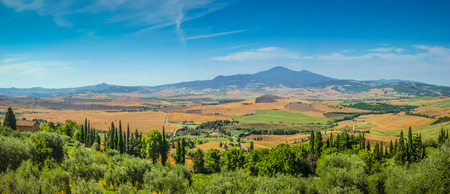 on the hill: Scenic Tuscany landscape with rolling hills and valleys on a beautiful sunny day, Val dOrcia, Italy Stock Photo