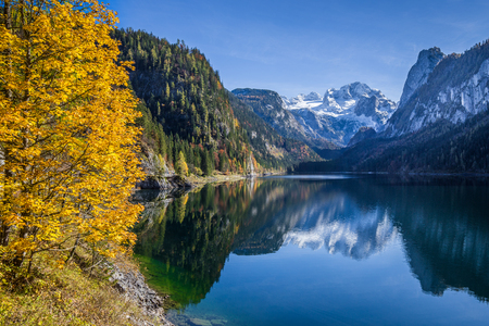 crystal clear: Beautiful view of idyllic colorful autumn scenery with Dachstein mountain summit Stock Photo