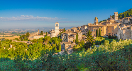 st  francis: Panoramic view of the historic town of Assisi in beautiful golden morning light at sunrise in summer, Umbria, Italy