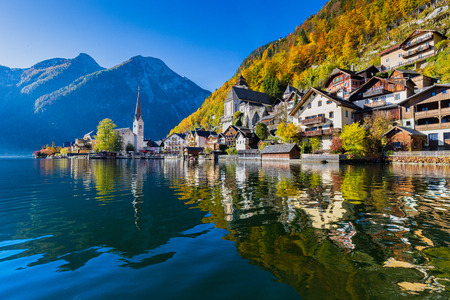 austrian village: Scenic picture-postcard view of famous Hallstatt mountain village with Hallstaetter Lake in the Austrian Alps in fall