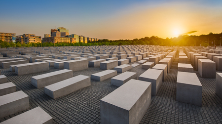 Famous Jewish Holocaust Memorial near Brandenburger Tor Brandenburg Gate at sunset in summer, Berlin Mitte, Germany