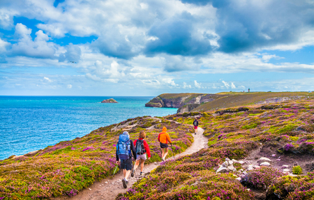 bretagne: Tourists hiking along the beautiful coast of Bretagne at famous Cap Frehel viewpoint Stock Photo