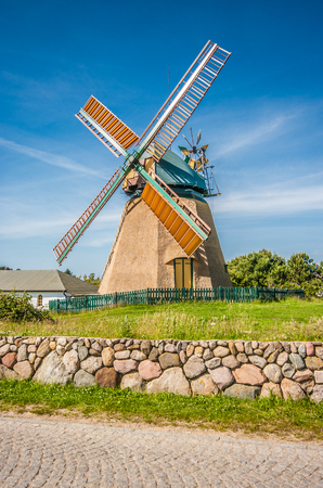 blue summer sky: Traditional windmill in beautiful scenery with blue sky and clouds on a sunny day in summer