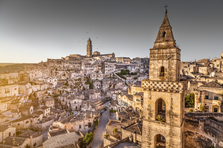 southern european: Ancient town of Matera, European Capital of Culture 2019, in beautiful golden morning light, Basilicata, southern Italy