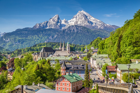 berchtesgaden: Historic town of Berchtesgaden with famous Watzmann mountain in the background on a sunny day with blue sky and clouds in springtime, Nationalpark Berchtesgadener Land, Upper Bavaria, Germany Stock Photo