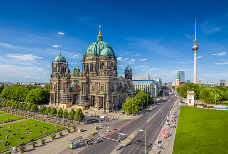 alexander: Aerial view of Berlin Cathedral at Lustgarten park with famous TV tower in the background on a sunny day with blue sky and clouds in summer, Berlin Mitte district, Germany Stock Photo