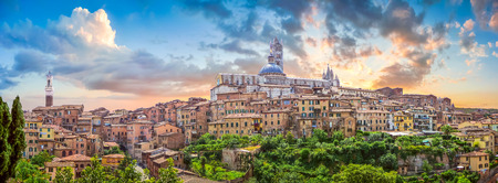 heritage site: Beautiful panoramic view of the historic city of Siena at sunset with an amazing cloudscape on an idyllic summer evening, Tuscany, Italy