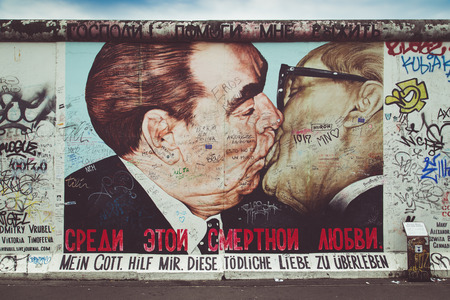 mauer: BERLIN, GERMANY - JULY 12: Street art graffiti painting The Kiss by Dmitri Vrubel at famous East Side Gallery, the longest preserved section of the Berlin wall, on July 12, 2015 in Berlin, Germany. Editorial