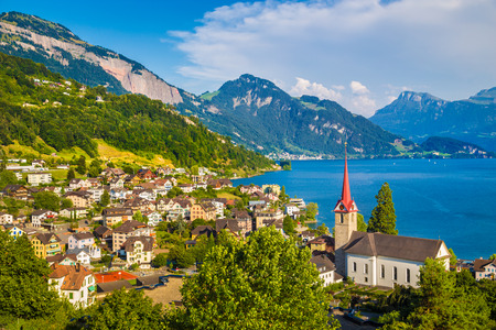Beautiful mountain scenery with the town of Weggis at the northern shore of Lake Lucerne in beautiful evening light at sunset, Canton of Lucerne, central Switzerland