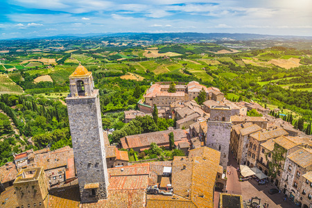 wideangle: Aerial wide-angle view of the historic town of San Gimignano with Tuscan countryside on a sunny day, Tuscany, Italy Stock Photo