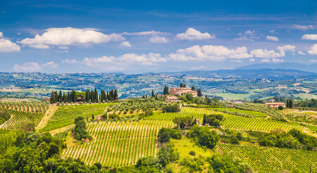 val d'orcia: Scenic Tuscany landscape with rolling hills and valleys on a sunny day with blue sky and clouds in Val dOrcia, Italy