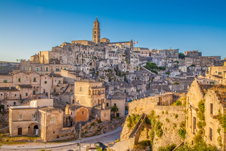 southern european: Ancient town of Matera (Sassi di Matera), European Capital of Culture 2019, in beautiful golden morning light, Basilicata, southern Italy