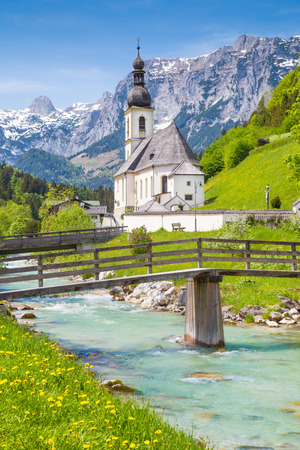 austrian village: Scenic mountain landscape in the Bavarian Alps with famous Parish Church of St. Sebastian in the village of Ramsau in springtime, Nationalpark Berchtesgadener Land, Upper Bavaria, Germany Stock Photo