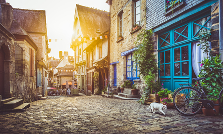 Old town in Europe at sunset with retro vintage style filter and lens flare effect
