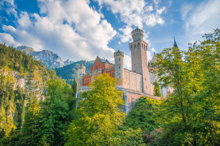 schloss: Beautiful view of world-famous Neuschwanstein Castle, the 19th century Romanesque Revival palace built for King Ludwig II, on a sunny day, Fussen, southwest Bavaria, Germany