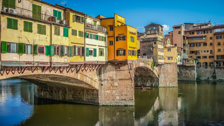 vechio: Beautiful view of famous Ponte Vecchio with river Arno at sunset on an idyllic summer evening in Florence, Italy