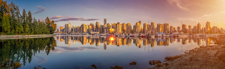 Panoramic view of beautiful Vancouver skyline and famous harbor area from stanley park in idyllic evening light at sunset in summer, British Columbia, Canada