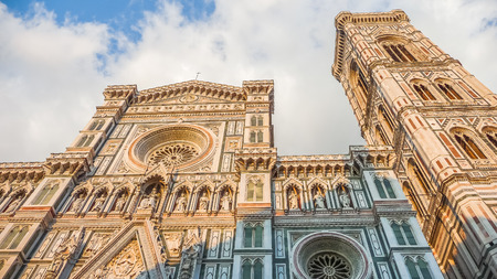 the campanile: Famous Cathedral Santa Maria Del Fiore with Giottos Campanile at sunset on Piazza del Duomo in Florence, Tuscany, Italy