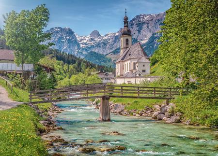 berchtesgaden: Scenic mountain landscape in the Bavarian Alps with famous Parish Church of St. Sebastian in the village of Ramsau, Nationalpark Berchtesgadener Land, Upper Bavaria, Germany Stock Photo
