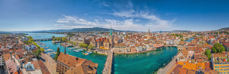 st  peter: Aerial view of Zurich city center with famous Fraumunster and St. Peter Churches and river Limmat at Lake Zurich from Grossmunster Church on a sunny day with blue sky in summer, Canton Zurich, Switzerland Stock Photo