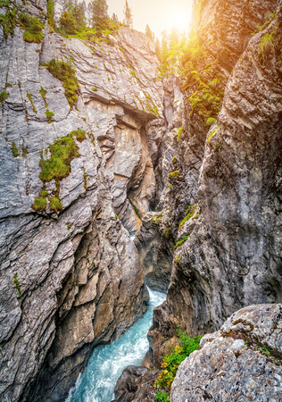 monch: Beautiful view of famous mystical Rosenlaui glacier gorge (Rosenlaui Gletscherschlucht), a UNESCO World Heritage since 2001, from a narrow hiking trail in the Bernese Alps in summer, Switzerland Stock Photo