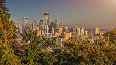 Beautiful panoramic view of Seattle skyline seen from Kerry Park at sunset in golden evening light with Mount Rainier in the background in summer, Washington State, United States of America Stock Photo