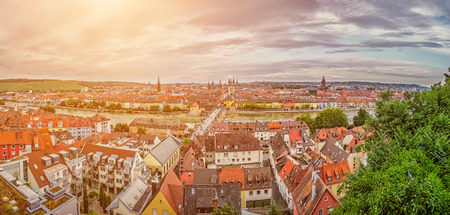 residenz: Beautiful panoramic view of the historic city of Wurzburg in idyllic golden evening light at sunset in summer, region of Franconia, Northern Bavaria, Germany