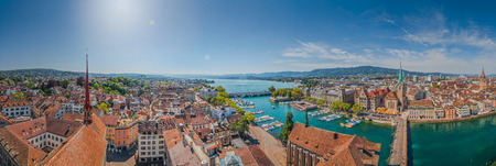grossmunster cathedral: Aerial view of Zurich city center with famous Fraumunster Church and river Limmat at Lake Zurich from Grossmunster Church on a sunny day in summer, Canton of Zurich, Switzerland