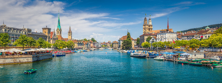 Panoramic view of historic Zurich city center with famous Fraumunster, Grossmunster and St. Peter and river Limmat at Lake Zurich on a sunny day with clouds in summer, Canton of Zurich, Switzerland