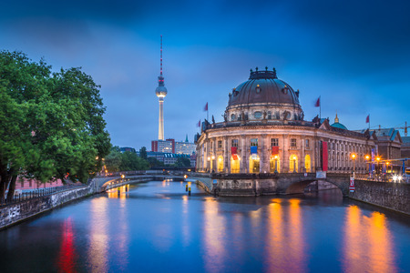 Beautiful view of Berlin Museumsinsel with famous TV tower and Spree river in twilight during blue hour at dusk, Berlin, Germany Stockfoto