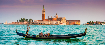 venice bridge: Beautiful view of traditional Gondola on Canal Grande with San Giorgio Maggiore church in the background at sunset, San Marco, Venice, Italy