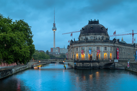 bode: Beautiful view of famous Bode Museum at historic Museumsinsel (Museum Island) with TV tower and Spree river in twilight during blue hour at dusk, Berlin, Germany Stock Photo