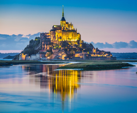 mount saint michael: Panoramic view of famous Le Mont Saint-Michel tidal island in beautiful twilight during blue hour at dusk, Normandy, northern France