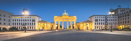 mauer: Panoramic view of famous Brandenburger Tor (Brandenburg Gate), one of the best-known landmarks and national symbols of Germany, during blue hour with retro vintage filter, Berlin, Germany Stock Photo