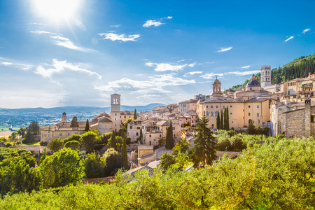 Panoramic view of the historic town of Assisi on a beautiful sunny day with blue sky and clouds in summer, Umbria, Italy